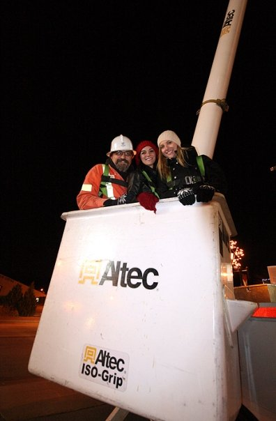 Light Up 2009 - My dad, my sister & I up in the bucket truck to watch the fireworks.